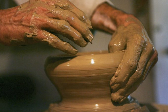 RISHTAN, UZBEKISTAN - AUGUST 13: (ISRAEL OUT) An Uzbek potter turns locally-dug clay on a wheel to prepare a bowl in a workshop, making the blue ceramics that the region is famous for on  August 13, 2006 in Rishtan in the Fergana Valley in the central Asian country of Uzbekistan. Fifteen years after the breakup of the former USSR, the millions of Muslims living between the Caspian Sea and China, who for decades found themselves repressed under Communism, are experiencing an economic and religious revival. Following the August 1991 abortive coup attempt in Moscow and the subsequent dissolution of the Soviet Union, Uzbekistan declared independence on August 31, 1991. (Photo by Uriel Sinai/Getty Images)
