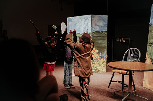 children performing in theatre class at Edmond Fine Arts