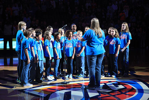 Edmond Youth Chorus performing at an OKC Thunder game